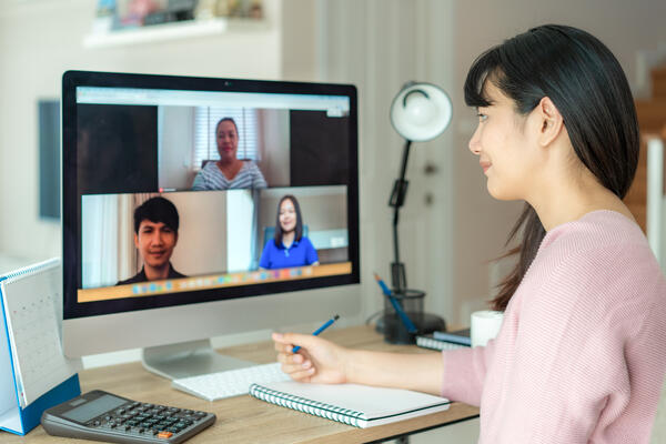 employees collaborating via video conferencing